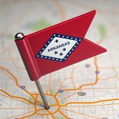 Arkansas Small Flag on a Map Background.