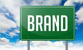 Brand on Highway Signpost.