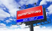 Outstaffing on Red Billboard.