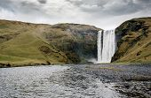 Famous Skogafoss waterfall in Iceland at dusk
