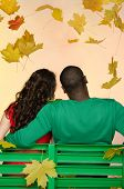 African American Man And Asian Woman Under Leaf Fall From