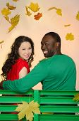 African-American Man And Asian Woman Under The Leaves