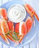 picture of cooked blue crab  - crab claws with sauce on the plate - JPG