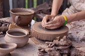 A Potter Shapes A Piece Of Pottery