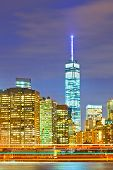 pic of freedom tower  - New York City USA colorful cityscape of Manhattan buildings and moving traffic at sunset - JPG
