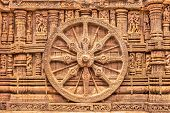 pic of chariot  - A chariot wheel carved into the wall of the sun temple at Konark - JPG