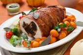 Cut Piece Of Bacon-wrapped Turkey Breast Roulade