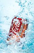 MOSCOW, RUSSIA-APRIL 4, 2014: Can of Coca-Cola Vanilla in water. Coca-Cola is a carbonated soft drink sold in stores, restaurants, and vending machines throughout the world.