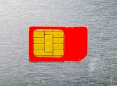 Macro Of The Old Red Sim Card