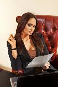 beautiful young woman reads the document at office