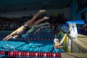 Treviglio ( Bergamo - Italy)  - October 19: Unidentified Swimmers Starting A Race On Swimming Pool