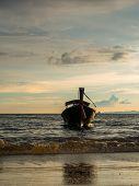 Long tailed boat Ruea Hang Yao at sunset in Krabi Thailand