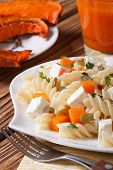 Fusilli Pasta With Feta And Pumpkin On A Plate Close Up. Vertical