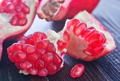 picture of pomegranate  - fresh pomegranate on the wooden table, ripe pomegranate pieces