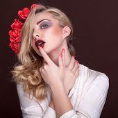Sensual Woman With Finger On Her Lips