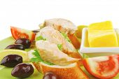foto of butter-lettuce  - salmon on baguette slices with butter and dark olives - JPG