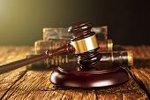 picture of court hammer  - Wooden gavel and books on wooden table - JPG