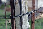 Metal Chain On Old Wooden Fence