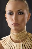 image of blonde woman  - closeup portrait of attractive blond woman like an amazon with a necklace made of wood peg - JPG