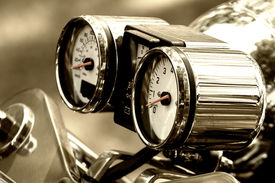 picture of mph  - close up view of a motorcycle dashboard in sepia colors - JPG