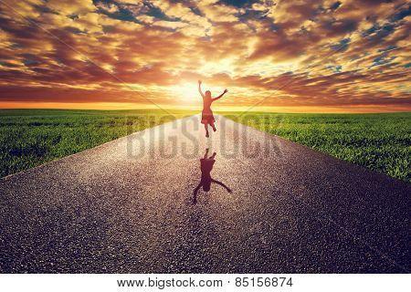 Happy lady hopping on long straight street, way towards dusk sun. Travel, bliss, win, solid l