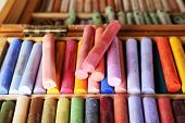 pic of pastel colors  - Colorful chalk pastels in box close up - JPG