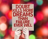 foto of kill  - Doubt Kills More Dreams Than Failure Ever Will card with colorful background with defocused lights - JPG