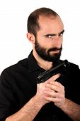 pic of gun shot  - Studio shot of a man holding a gun - JPG