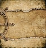 foto of steers  - steering wheel and torn vintage nautical map  - JPG