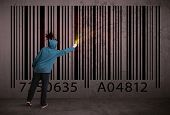 image of barcode  - Young urban painter drawing a barcode on the wall  - JPG