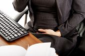 stock photo of  belly  - Pregnant woman touching her belly in the office - JPG