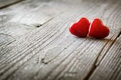 pic of two hearts  - Two hearts on a wooden background concept for love - JPG