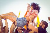 image of gathering  - Happy hipster woman crowd surfing at a music festival - JPG