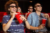 picture of cinema auditorium  - Young friends watching a 3d film at the cinema - JPG