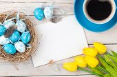 stock photo of egg whites  - Easter background with blue and white eggs in nest - JPG