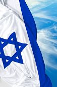 stock photo of israeli flag  - Israeli waving flag on a beautiful day - JPG