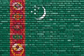 stock photo of turkmenistan  - flag of Turkmenistan painted on brick wall - JPG