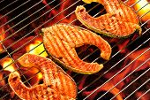 image of flame-grilled  - Grilled salmon on the flaming grill - JPG
