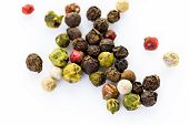 picture of peppercorns  - Bold and varied peppercorns on a white background - JPG