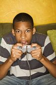 stock photo of video game  - Handsome young man Playing a Video Game with Handheld Controllers - JPG