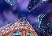 stock photo of singapore night  - Skysrapers in Singapore during night hours - JPG