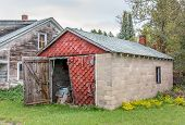 foto of farm-house  - Abandoned farm house and garage in rural United States - JPG