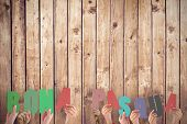 stock photo of pasqua  - Hands holding up bona pasqua against wooden planks - JPG