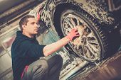 picture of alloy  - Man worker washing car - JPG
