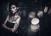 pic of spooky  - Tattooed beautiful woman in old spooky interior - JPG