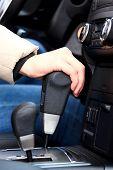 stock photo of gear-shifter  - Woman driving a car - JPG