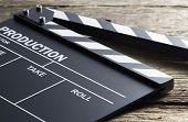 stock photo of clapper board  - Movie clapper on wood background - JPG