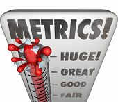 stock photo of benchmarking  - Metrics word on a thermometer or gauge measuring performance or results of a marketing campaign - JPG