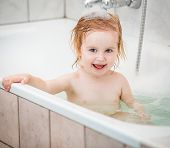 pic of 15 year old  - cute two year old baby bathes in a bath with foam closeup - JPG