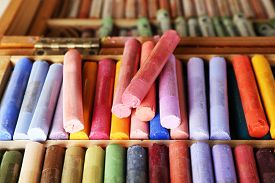 stock photo of pastel  - Colorful chalk pastels in box close up - JPG